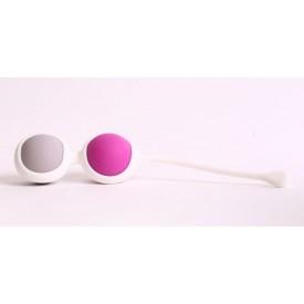 Вагинальные шарики разного веса в белом держателе